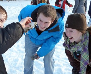 A Sherman Middle school student shows off a raccoon jaw he found in the dog park to his UW mentors.