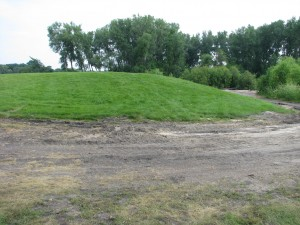 The shooting island hill after the 2013 fireworks display. This soil was tested by state and federal regulators and found to be in violation of the Clean Water Act of 1972. (Jim Carrier)